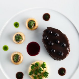 BRAISED BULL'S CHEEKS WITH RED WINE AND BLACKCURRANT, MUSHROOMS FILLED WITH SNAILS, POLENTA CREAM WITH BROCCOLI
