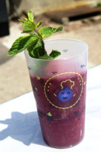 glass of blackcurrant smoothie with the logo Best of Cassis over it