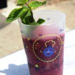 "ecocup ""Best of Cassis"", with strawberry, watermelon & blackcurrant smoothie, with a twig of mint in it"