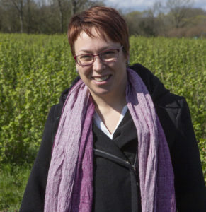 IBA General Manager Stefanie Sharma standing in a blackcurrant field