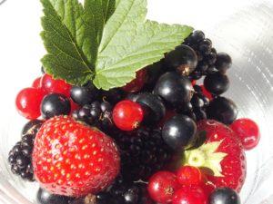 bowl of several berries, including blackcurrants in June