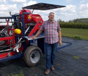 Andris Krogzems with one of his machines