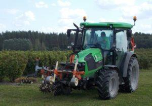 tractor doing weeding in the Krogzeme farm