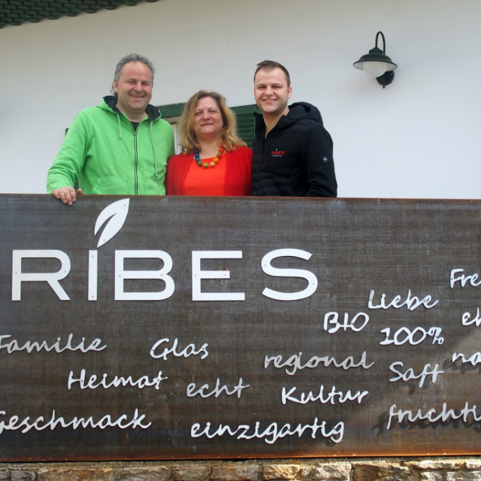 "Franz, Gudrun and Bernhard Schriebl in front of their farm shop ""Ribes"""