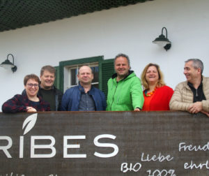 IBA Executive and Franz and Gudrun Schriebl, blackcurrant growers in Austria, standing in front of the Ribes farm
