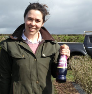 Harriet Prosser, LRS, holding a bottle of Ribena. She is part of the project for climate-resilient blackcurrant varieties.